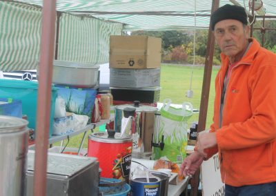 Lion Mick providing hot drinks for the set up