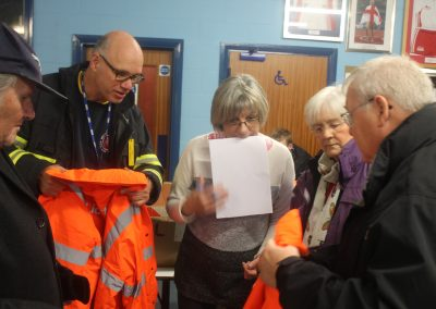 Giving out high vis etc